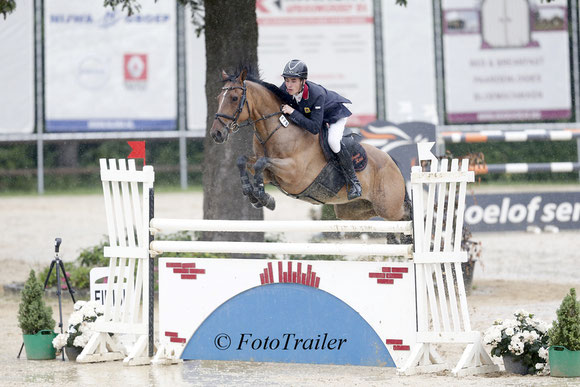 Fraser Reed on Harry, winning the 1.30m pony class. Photo FotoTrailer