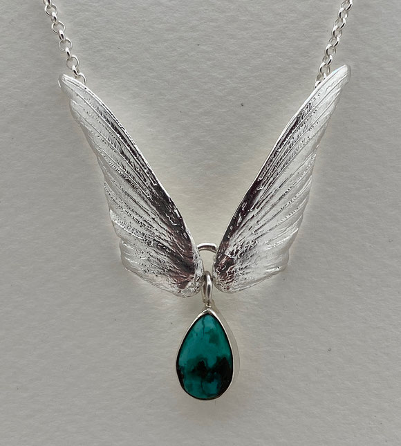 Sterling Silver humming bird wing with articulated wings.  Blue Turquoise $135.00