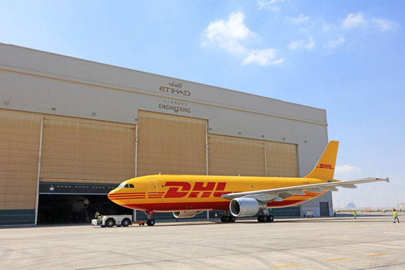 DHL A300F taxiing in front of Etihad hangar  - courtesy DHL