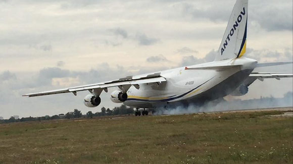 AN-124 with smoking tyres  -  courtesy Antonov Airlines