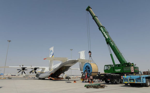 Unloading of the coil reel after landing of the AN-22F in Abu Dhabi  -  courtesy Antonov.