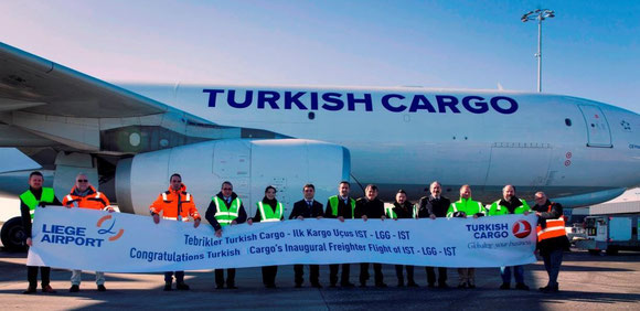 Representatives of Liege Airport and Turkish Cargo welcome the first A330F after its arrival at the Walloon airport  -  courtesy: LGG