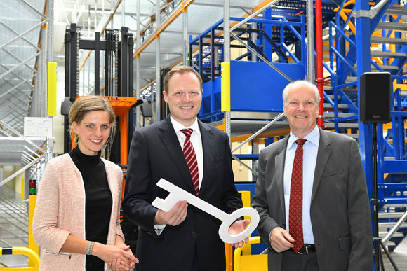 MUC's MD Thomas Weyer (standing right) handed over a symbolic key to LTLS exects Anna Henrichmann and Martin Kinzelt to access the facility -  courtesy MUC