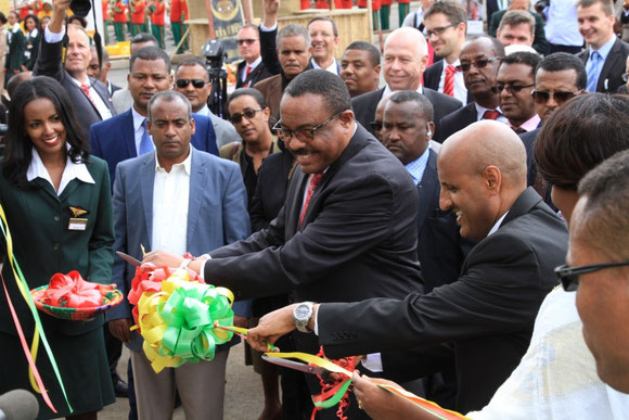 Ribbon cutting by Prime Minister Hailemariam Desalegn (standing left, with glasses) and ET CEO Tewolde GebreMariam