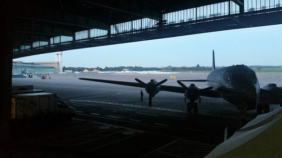 DC-4 standing at Tempelhof as reminiscence of the raisin bomber era during the Berlin Airlift shortly after WW II.