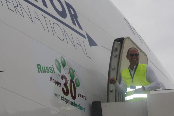 Chapman Freeborn honors CEO Russi Batliwala (standing on ladder) for 30 y of tireless dedication, displaying his name on the fuselage of a B747-400F parked at Hahn Airport -  picture: CF
