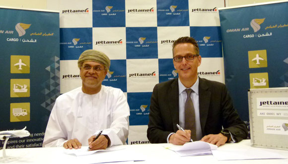 Signing the pact: Mohammed Al Musafir, SVP Commercial Cargo, Oman Air Cargo and Thorsten Riekert, Director Sales, Jettainer  -  courtesy: JT