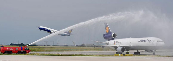 LH Cargo MD-11F and its two prominent panda passengers get a welcoming shower after landing at Berlin Brandenburg Int'l -  courtesy: Berliner Flughaefen