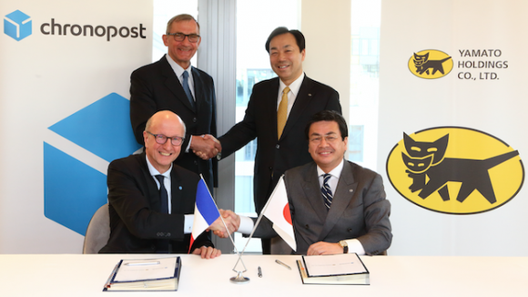 Standing (l > r): Paul-Marie Chavanne, GeoPost president and Masaki Yamauchi, representative director and CEO of Yamato Holdings.  Sitting (l > r): Martin Piechowski, Chronopost president and Katsihiko Umetsu, senior officer of Yamato Holdings.