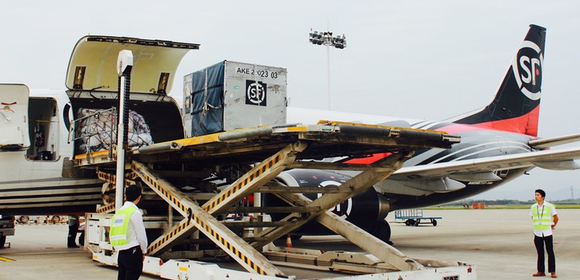 Unloading of one of SF Airlines' Boeing 757 freighter aircraft