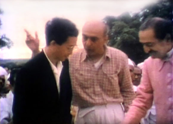 Mr. Hitaka is being spoken to by Pendu Irani ( middle ) in Baba's presence.