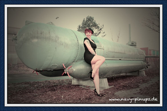 "Navy Pin Up Model Cathy with a mini sub of type ""Molch"", built in WWII."
