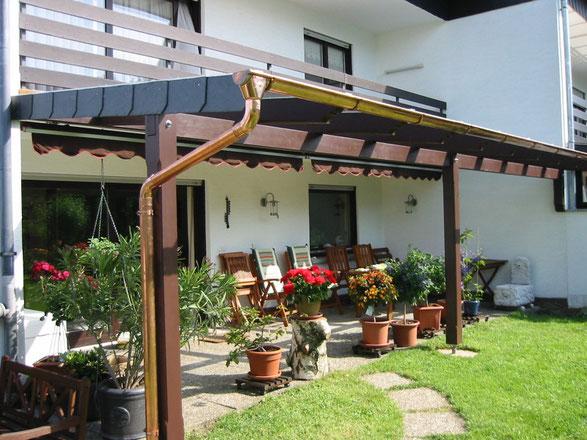 Terrassendach Leimholz in mahaghoni braun mit Kupferrinne und 8mm Glaseindeckung VSG  . Terrassendach  Höhr-Grenzhausen Terrassenüberdachung