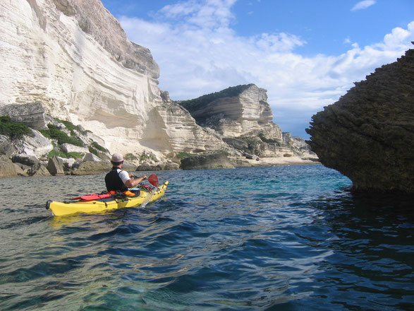Sea kayaking beneath the cliffs of Bonifacio, Corsica (France)