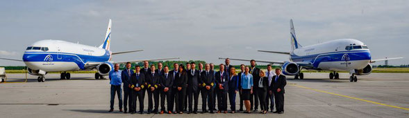 CargoLogic Germany staff flanked by two 737-400Fs at Leipzig-Halle Airport -  courtesy CLG