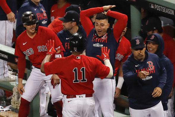 I Red Sox festeggiano (AP Photo/Michael Dwyer)