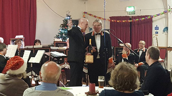Michael Tindall (Tinny) receiving from MD David Dernley his award for 50years  with the same band