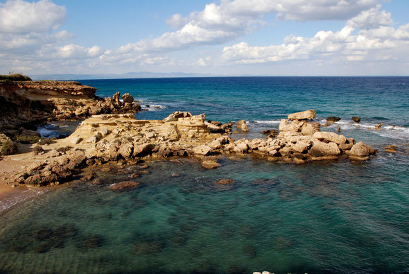The Greek Cypriot coast near the Green Line, the Karpas eninsula stretching along the horizon to the north-east