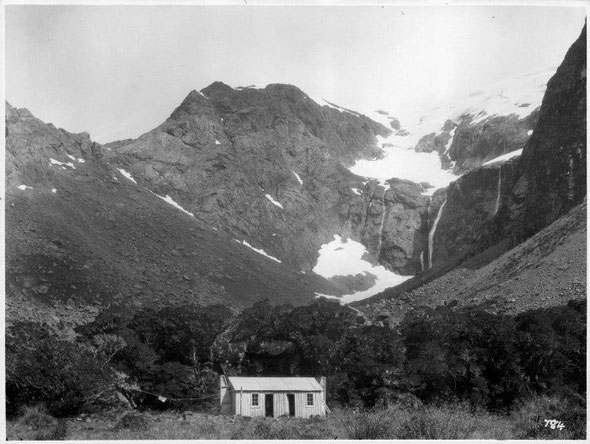 By complete chance the photo above and this one are almost the same but separated by nearly 100 years. View looking up the Homer Valley, showing the Homer Hut in the foreground, photographed in the 19