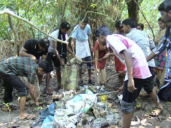 Collecting garbage before tree planting on 30 Novermber 2013.