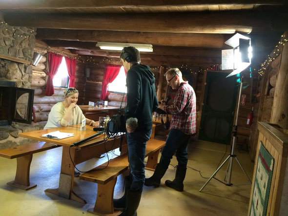 Lighting up the log cabin with The Best of Nova Scotia production team.