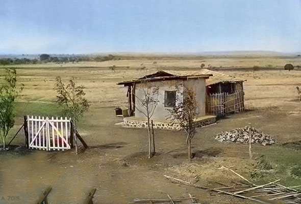 The Tin Cabin, behind which can be seen the tatta-matting around the crypt-room, in 1935 - Note the construction debris left in a pile because of Baba's seclusion- Photo taken by Padri. Image colourized by Anthony Zois.