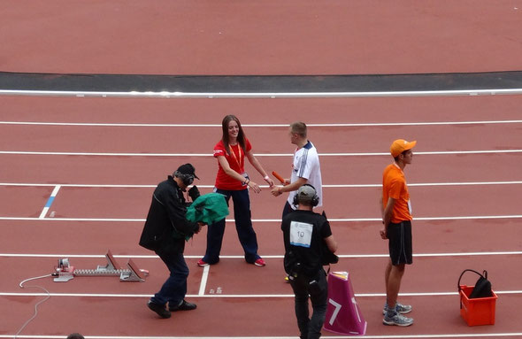 Catherine Hardy handing over the relay baton