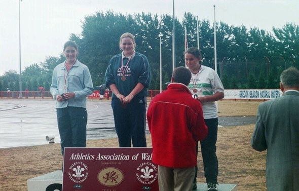 Tanya Bilous (centre) receiving her U17 Womens Hammer gold medal