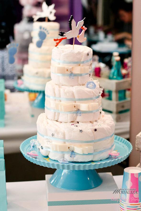 diaper cake gâteau de couches bébé blue bleu ours ruban étoiles tétine crème ivoire baby