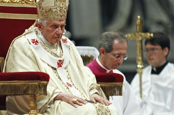 (Pope Benedict XVI looks on as he leads the Chrismal mass in Saint Peter's Basilica at the Vatican April 5, 2012. REUTERS/Max Rossi )