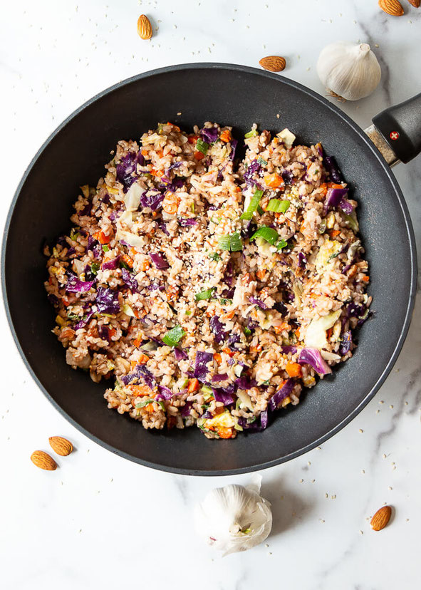 Want a healthy fried rice recipe that's easy to make? This fried rice with egg is a vegetarian recipe that's tasty homemade Chinese food! @nowfoods #ad #nowwellness #glutenfree #friedrice #chinesefood #vegetarian #ricerecipe #brownrice