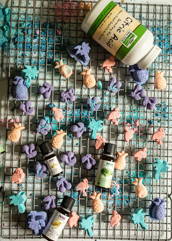 Looking for DIY shower bomb recipes? These shower bombs are made with essential oils for energy and calmness. Get the intel on how to make these shower melts with baking soda and citric acid. Then share how much you're enjoying the shower fizzies.