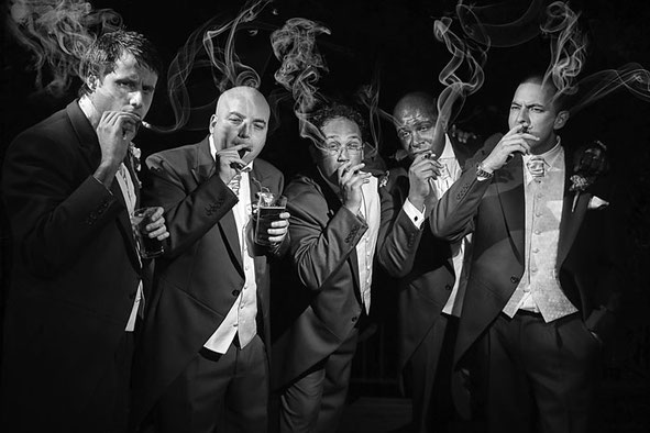 Diverse Gentlemen Smoking A Cigar