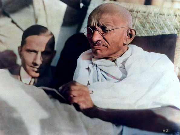 Gandhi reading while travelling on the SS Rajputana. Image colourized by Anthony Zois.