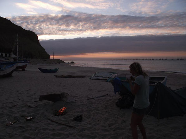 Cabo Blanco, Peru- building a cooking fire on the beach.