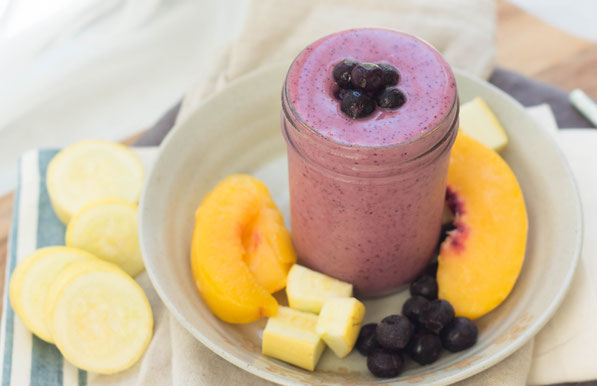 Yellow squash blends into this blueberry-peach smoothie beautifully! This smoothie is a healthy, creamy, gluten free, vegetarian breakfast option that's so refreshing in these hot summer months!