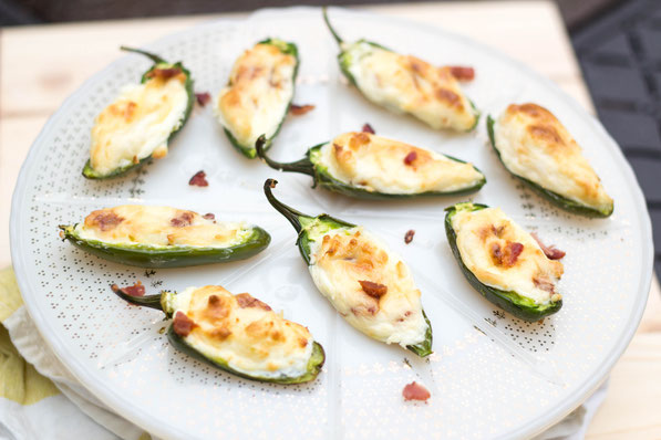 These lighter bacon cream cheese stuffed jalapeno poppers are the best appetizer recipe!  Everyone will love them and no one will notice they're a healthier snack option!