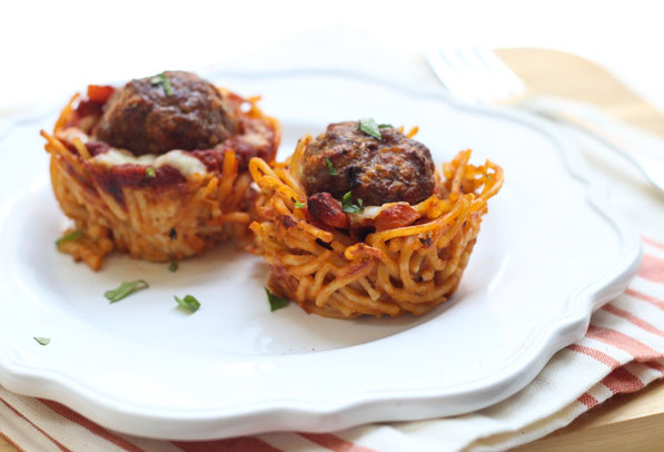 "This fun version of spaghetti and meatballs is baked in a muffin tin to make ""nests."" It's a beautiful, perfectly portioned dinner the whole family will love!"