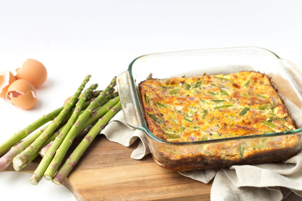 Fresh asparagus makes the perfect veggie base for this cheesy ham and egg casserole!