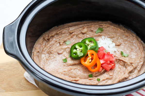 Creamy, flavorful refried beans are so easy to make in the slow cooker! These refried beans are a healthier, vegan version of classic refried beans that the whole family will love!