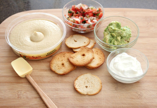 This is an easy recipe that's perfect for tailgating season!  A few simple store-bought items come together in minutes to make these Southwestern hummus bites.  Everyone will love this tasty, healthy snack!