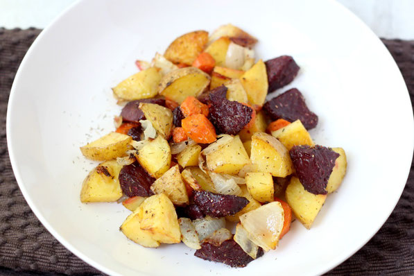 This beautiful medley of roasted beets, potatoes, and carrots with garlic-thyme seasoning makes for one delicious side dish!