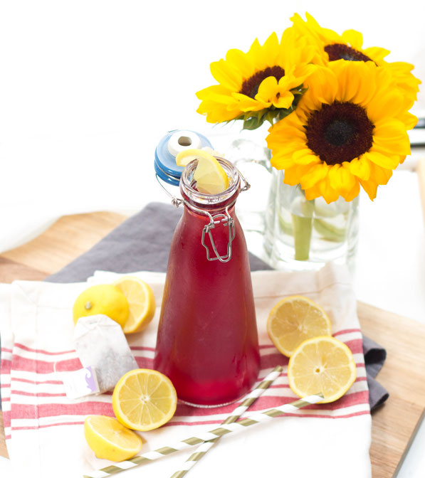It's getting hot outside, which means it's time for some refreshing summer drinks!  This easy lemonade made with passion tea is perfect for entertaining or for a light, slightly sweet drink.
