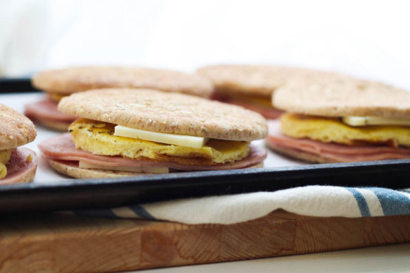 "Freezer-friendly egg sandwiches with ham, pepper jack cheese, and whole grain sandwich thins are the ultimate healthy ""fast food"" breakfast recipe!  It's a fun breakfast the whole family will love for weekdays!"