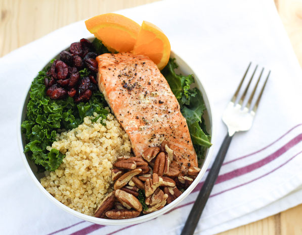 This colorful protein bowl recipe made with kale, salmon, quinoa, pecans, and cranberries is a protein-packed, fiber-filled healthy lunch that will keep you full and fueled all afternoon!
