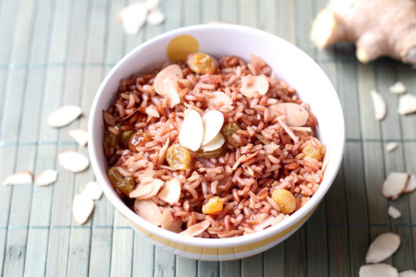 Fresh ginger, almonds, and golden raisins make this easy pink rice pilaf extra special!