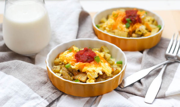 These easy and affordable potato, egg, and cheese breakfast bowls are a healthy, gluten free, and freezer-friendly recipe that costs around $0.52 per serving!