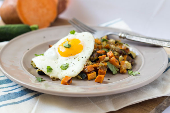 This simple, delicious seven-ingredient vegetarian roasted veggie hash with eggs is the perfect healthy breakfast-for-dinner recipe!