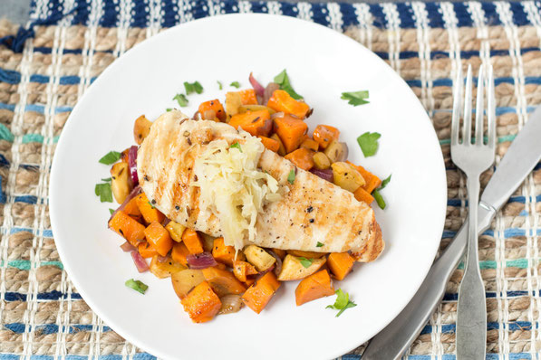 Roasted sweet potatoes, apple, and onion complement this marinated orange-maple chicken perfectly.  Serve with raw sauerkraut for a boost of nutrition and probiotics for this healthy dinner!