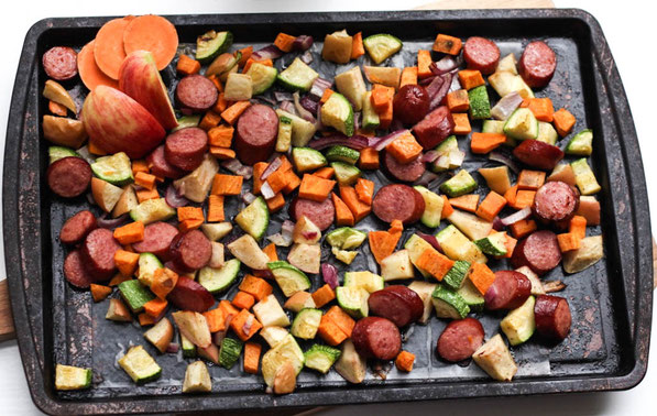 This easy sheet pan dinner made with turkey sausage,  sweet potatoes, apples, and zucchini is the perfect quick weeknight fall-inspired healthy dinner recipe!